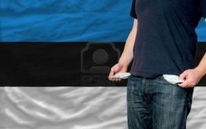 12063235-poor-man-showing-empty-pockets-in-front-of-estonia-flag